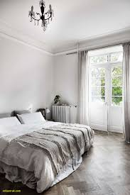 a beautiful and simple grey bedroom with grey bedding light grey walls and grey curtains