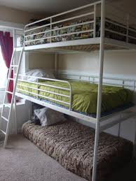 Triple Bunk Bed omg is that an ikea loft with another middle bed and  trundle?