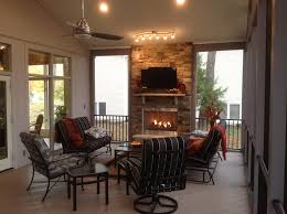 bright and airy shawnee ks porch with outdoor fireplace