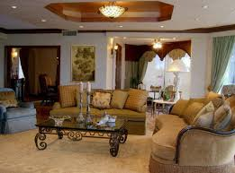 tuscan living rooms teak wood varnish coffee table crystal chandelier in high ceiling big arch wooden