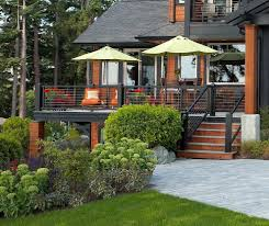 deck color schemes Porch Rustic with boulder cabin cable railing. Image by:  Dan Nelson Designs Northwest Architects