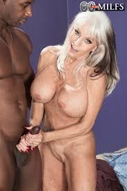 Horny older Sally D Angelo enoys big cock hanjob interracial.