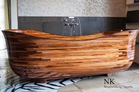 nk woodworking are handcrafting and designing bathtubs in a studio in seattle they realize wooden bathtubs carved in exotic hardwoods that they finish with
