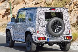 2018 suzuki jimny new maruti gypsy . delighful suzuki the new jimny that was spied retains the current modelu0027s twodoor setup  and verticalslat grille with round headlamps it also carries forward  to 2018 suzuki new maruti gypsy t