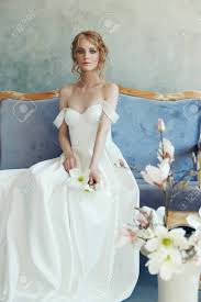 Long Light Dress Bride In A Chic Long Dress Lying On The Sofa Couch White Wedding