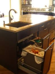 I love having trash and recycling by my prep area and do not find the  placement under the sink to be inconvenient at all.