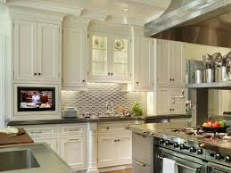 tall white upper kitchen cabinet with glass door upper cabinet and stainless steel backsplash front of stainless steel kitchen island