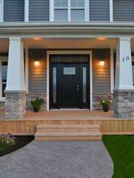 black front door with sidelightsIt Is Not Just a Front Door It Is a Gate  White trim Front