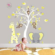 jungle nursery wall art featuring a giraffe elephant and monkeys around a white tree mural on elephant nursery wall art uk with jungle nursery wall art featuring a giraffe elephant and monkeys