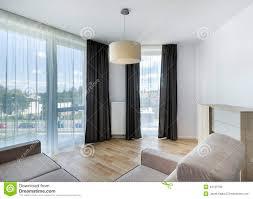 Modern Living Room For Apartment Big Windows In Modern Living Room Apartment Stock Photo Image
