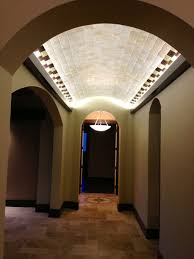 ceiling indirect lighting. led lit coves in the barrel ceiling on this hallway cast a soft glow indirect lighting