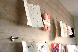 Using IKEA's DEKA curtain wire and clip to hang children's art.