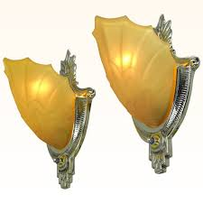 art deco wall sconces by globe lighting with amber color slip shades ant 539