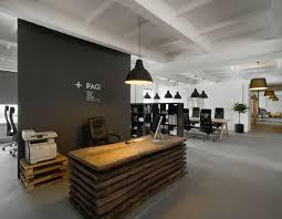 reclaimed wood reception desk by morpho studio