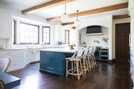 Kitchen island ideas Seating Spacious Transitional Kitchen With Blue Island Globe Pendant Lights Between Exposed Beams And Hgtvcom 15 Stylish Kitchen Island Ideas Hgtvs Decorating Design Blog Hgtv