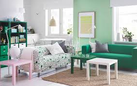 bedroom furniture ikea decoration home ideas: a bright living room with two two seat sofas one with a green cover