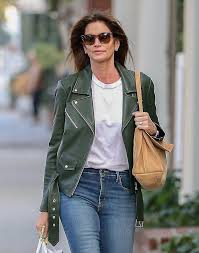 cindy crawford leather dark leaf green jacket white t shirt tan