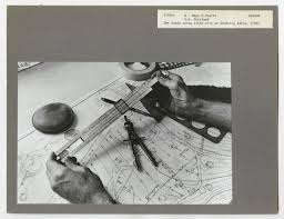 File C 1966 Two Hands Using A Slide Rule At A Drafting