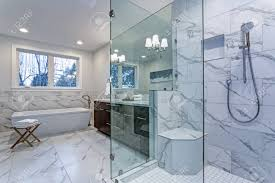 carrara marble tile. Incredible Master Bathroom With Carrara Marble Tile Surround, Modern Glass Walk In Shower, Espresso