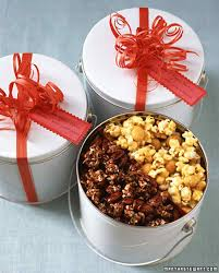 pack two kinds of homemade flavored popcorn in one bucket tin