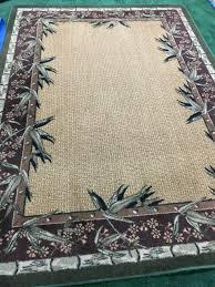 475 5 x 8 synthetic palm tree rug like new would look great in a sunroom a beach house or cottage etc