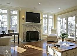 pictures of tv over fireplace tips for hanging a flat screen over fireplace apartment therapy pertaining