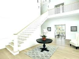 chandeliers jonathan adler ventana chandelier two story entry with round foyer table 2 tier oval