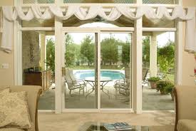 photo this custom made sliding patio door is incorporated into an entire wall made of high efficiency windows photo credit champion window