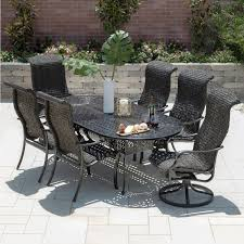 Du monde 7 piece banana leaf wicker patio dining set w 84 x 42 inch oval dining table 2 swivel rockers by lakeview outdoor designs bbq guys