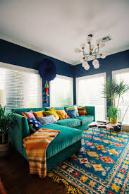 10 More Must-Have Pieces for Your Bohemian Home I love this sofa, wall  color, rug and the table- the light fixture, plants and Windows too