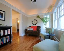 Traditional Medium Tone Wood Floor Living Room Idea In Chicago With Beige  Walls