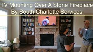 south charlotte tv mounting service over a stone fireplace installation in charlotte nc