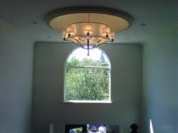 chandelier installed on a foyer in great neck ny