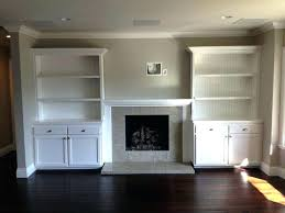 design around fireplace style built in cabinet