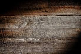 barn wood background. Old And Distressed Antique Grey Board Made Of Rough Sawn Barn Wood Plank With Vintage Weathered Textured Grain Grunge Background Stock Photo.