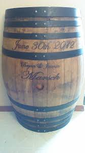 What can you do with a wine barrel? This person had a great idea: My  husband took this wine barrel and stained/painted it and wood burned our  wedding date ...