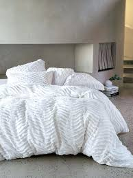 the drift white duvet cover set features a peaceful wave pattern in a superb chenile that