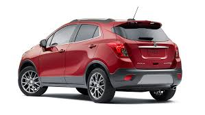 buick encore red. exterior photo of the driver side on a 2016 encore sport touring edition small luxury suv buick red