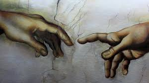 art s painting a replica of the hands in the creation of adam by michelangelo you