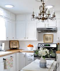 white painted cabinetsWhite painted kitchen cabinets with brass hardware  Jennifer Rizzo