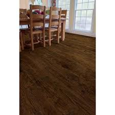 The surface texture and warm chocolate brown color tones of this laminate  flooring is rich and