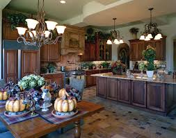 Appaling Metal Chandeliers Above Kitchen Dining Area With Tuscan Style  Kitchen Cabinets And Wide Island