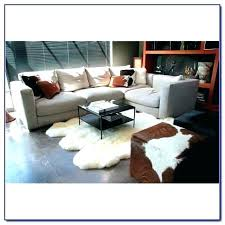 costco sheepskin rug faux white area rugs with cozy sofa and dresser lambskin cleaning canada sheeps