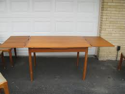 danish modern teak dining table and 4 chairs marked made in denmark sold