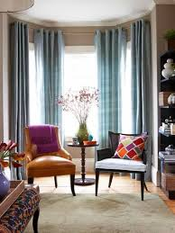 bay window with chairs and eyelet curtains