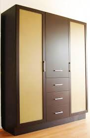 large portable wood closet with two doors and four drawers