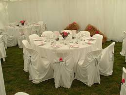 table setting close up round table garden chairs with covers
