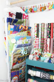 organizing with style an organized gift wrap closet blue i style creating an organized pretty happy home