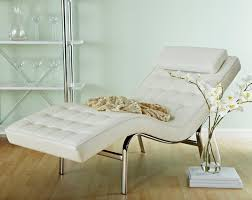 This chaise is a beautifully contemporary white leather design, with curved  chrome frame. Subtly