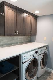 Laundry Room with Quartz Countertop and Glass Subway Tile Backsplash  traditional-laundry-room